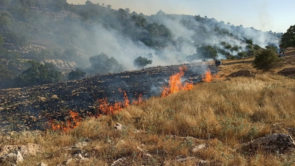 A picture obtained by AFP from Iranian news agency Tasnim on May 30, 2020, shows fires burning in a protected area in the Zagros mountain range, near the city of Behbahan in the Khuzestan province. (AFP)