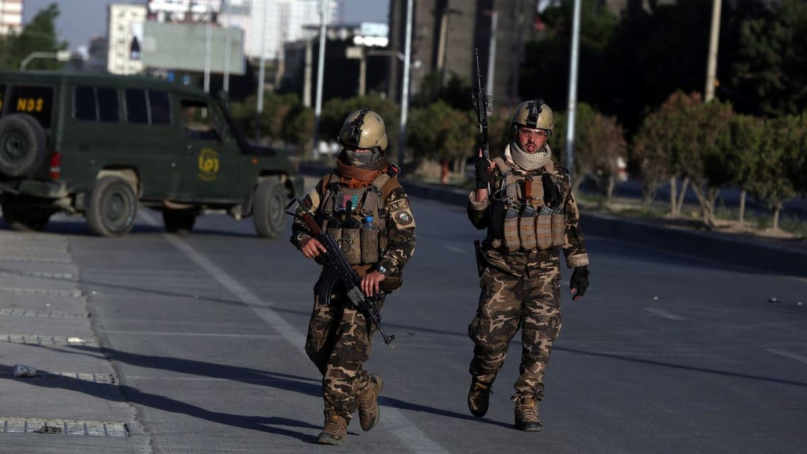 Afghan security forces inspect the site where a bus carrying local TV station employees hit a roadside bomb in Kabul, Afghanistan, Saturday, May 30, 2020. (File photo: AP)