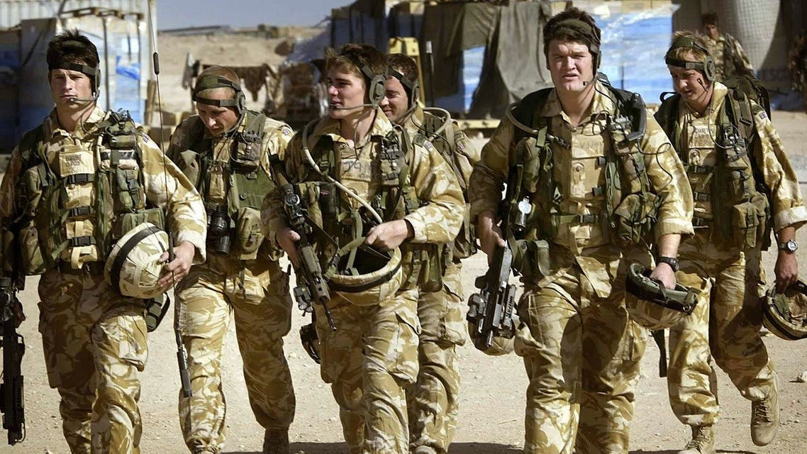 British Royal Marines Commandos attached to the Black Watch battle group prepare for a mission inside camp Dogwood 25 miles south of Baghdad, Iraq 18 November, 2004. (AFP)