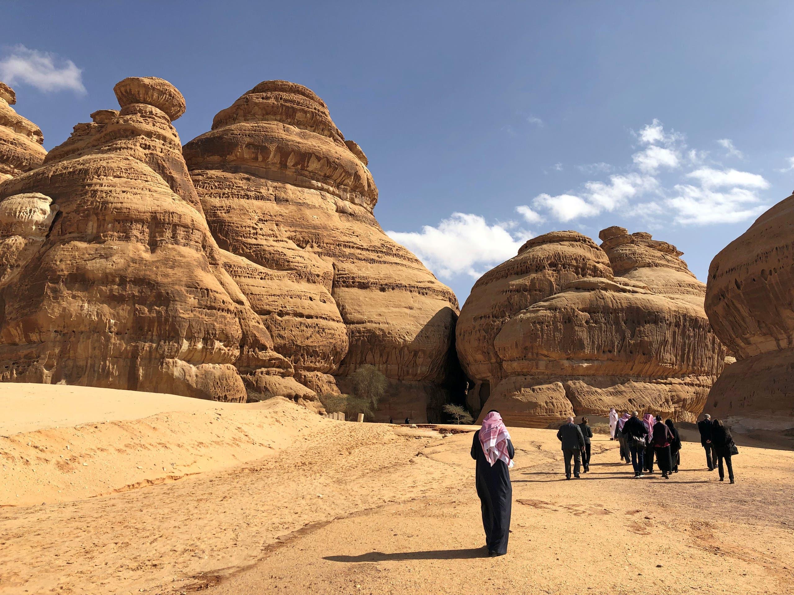 Visitors walk outside the tombs at the Madain Saleh antiquities site in al-Ula, Saudi Arabia February 10, 2019. (Reuters)
