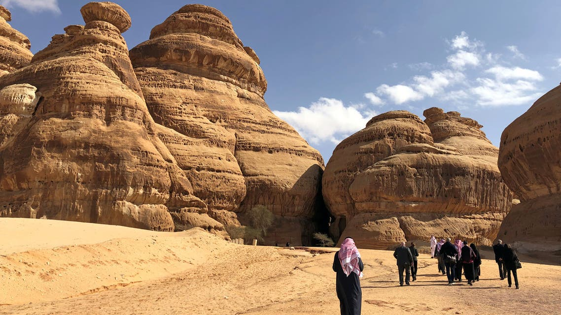 Visitors walk outside the tombs at the Madain Saleh antiquities site, al-Ula, Saudi Arabia February 10, 2019. (Reuters)