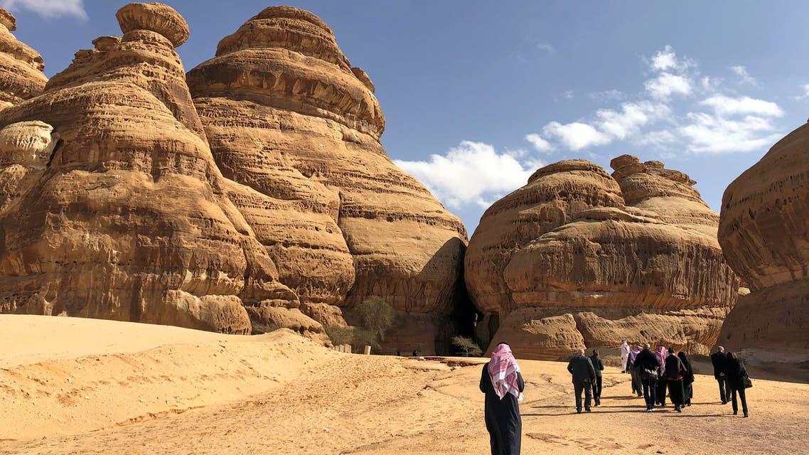 Visitors walk outside the tombs at the Madain Saleh antiquities site, al-Ula, Saudi Arabia February 10, 2019. (Reuters)