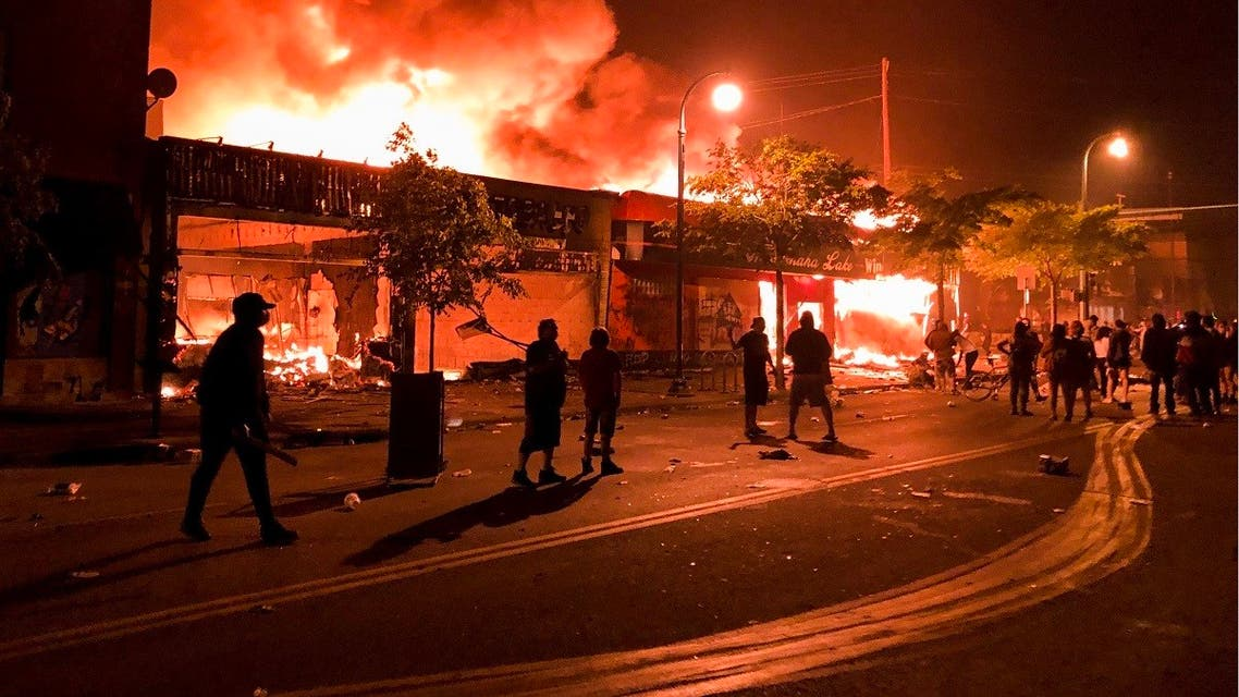 Flames rise from a liquor store and shops near the Third Police Precinct on May 28, 2020 in Minneapolis, Minnesota, during a protest over the death of George Floyd. (AFP)