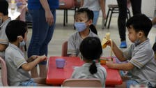 Coronavirus: Students in masks return to schools as Singapore eases restrictions