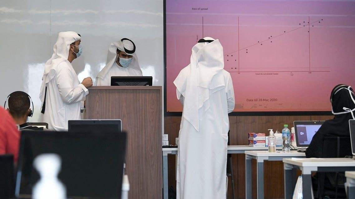 Operators man their posts at Dubai's COVID-19 Command and Control Centre at Mohammed bin Rashid University, in the United Arab Emirates, on June 1, 2020. (AFP)