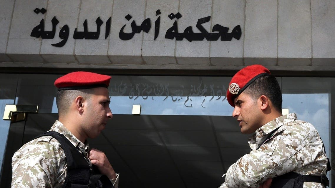 Jordanian security forces stand guard outside a military court as members of a cell accused of involvement in a shooting attack in 2016 go on trial at the military State Security Court in the Jordanian capital of Amman on November 13, 2018. (AFP)