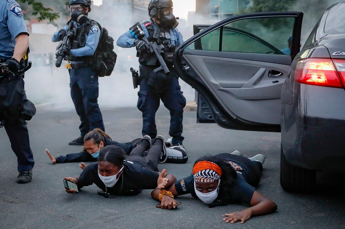 Motorists are ordered to the ground from their vehicle by police during a protest on South Washington Street, on May 31, 2020, in Minneapolis. (AP)