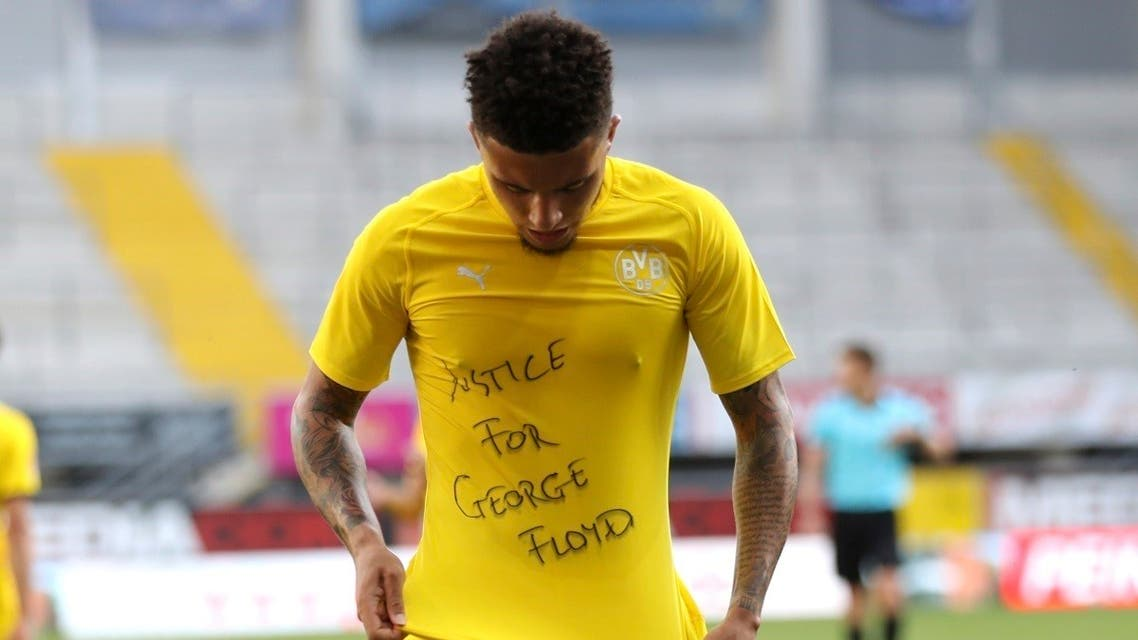 """Jadon Sancho displaying a T-shirt emblazoned with """"Justice for George Floyd."""" (AP)"""