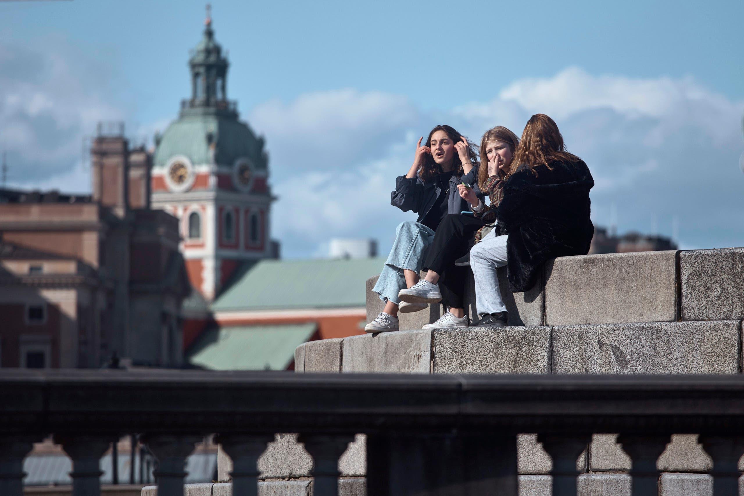 Young people socialise together in Stockholm, Sweden, Saturday, April 4, 2020. (AP)