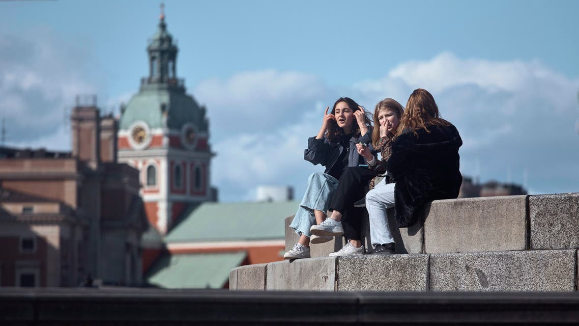 Young people socialise together in Stockholm, Sweden, Saturday, April 4, 2020. (AP)