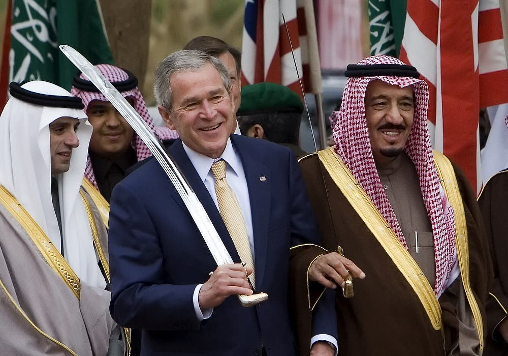 US President George W. Bush dances with a sword with Prince Salman bin Abdul Aziz (R), the brother of the Saudi king and Governor of Riyadh AFP