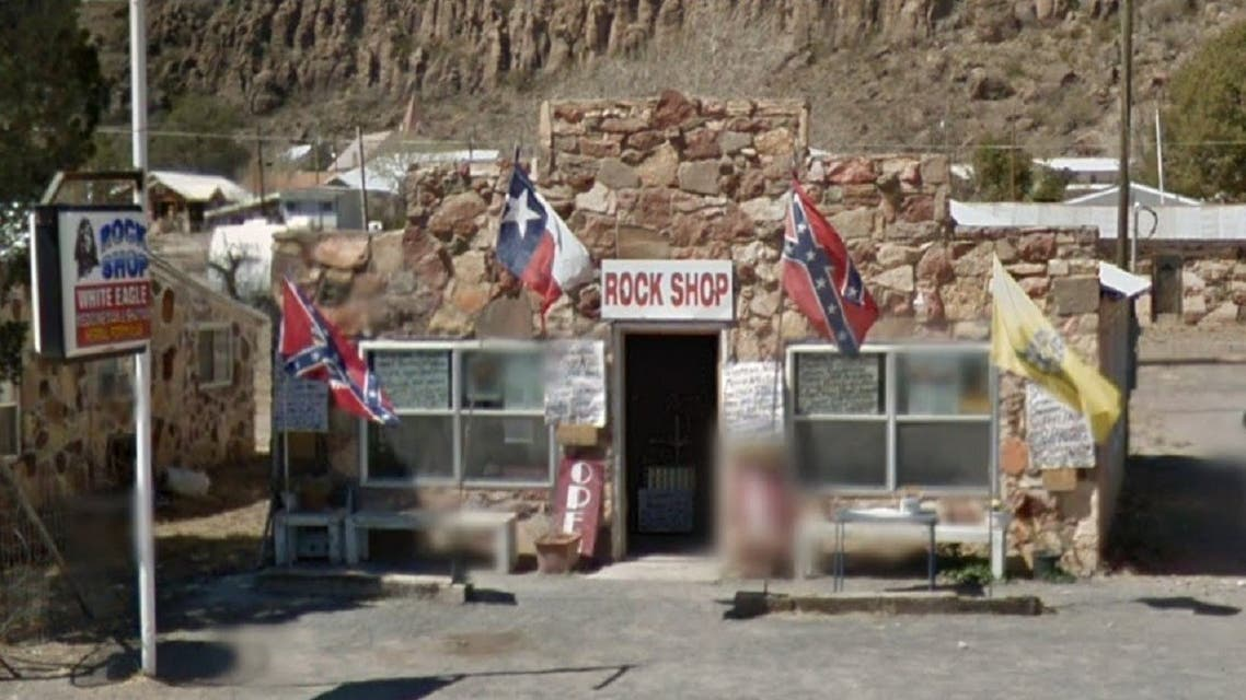 "Photographs reportedly show White Eagle's ""Rock Shop"" in person showed numerous Confederate flags. (Screengrab)"
