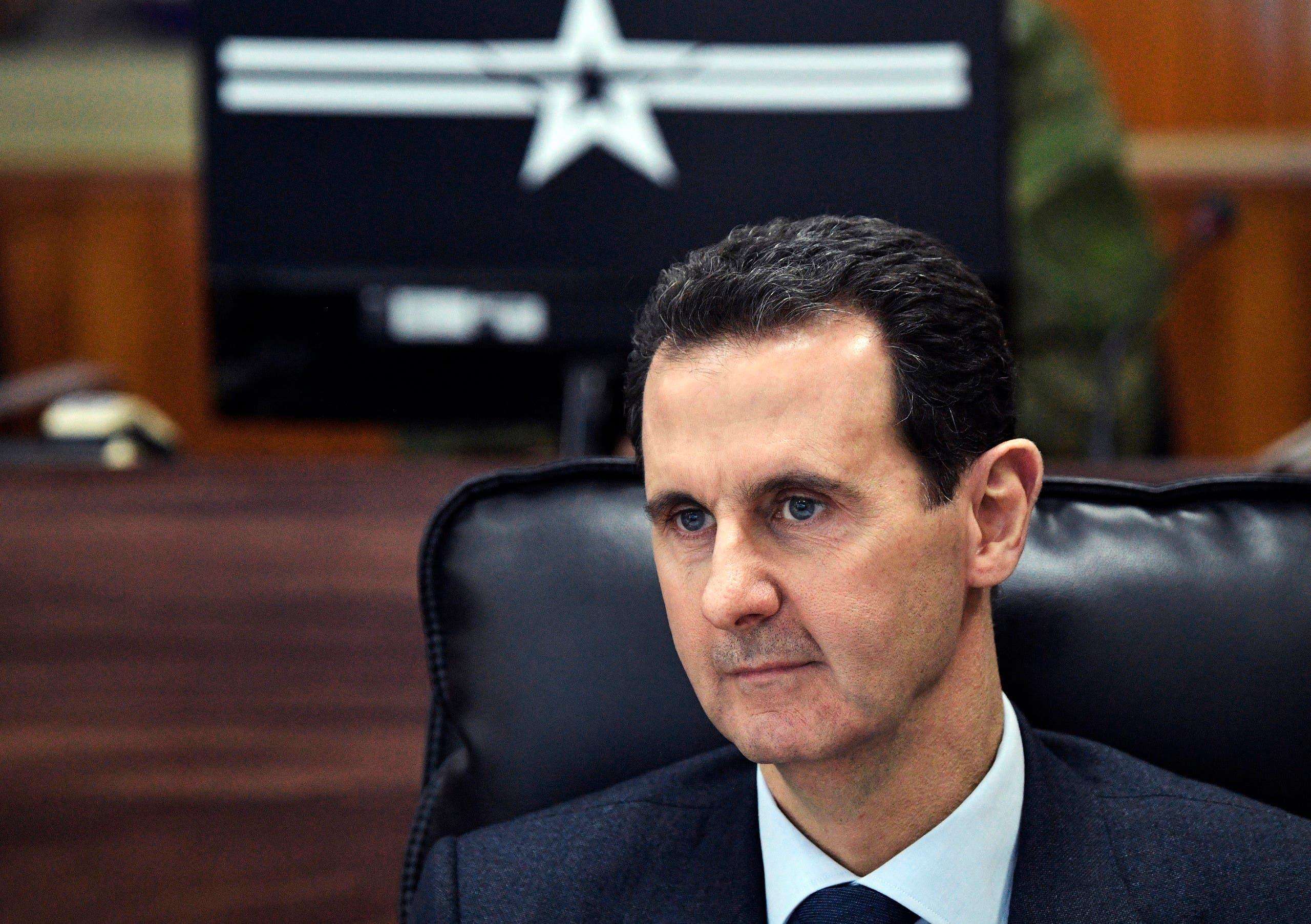 Syrian President Bashar Assad listens to Russian President Vladimir Putin during their meeting in Damascus, Syria on Jan. 7, 2020. (AP)