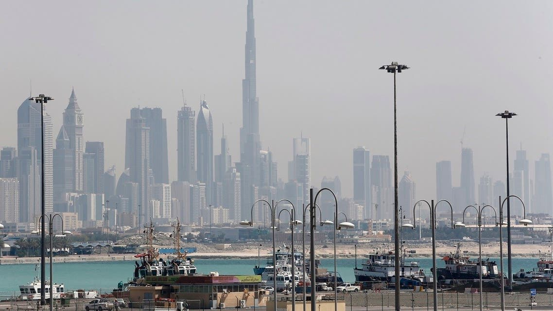 The skyline is seen with the Burj Khalifa as ships dock at Port Rashid, in Dubai May 26, 2013. (Reuters)