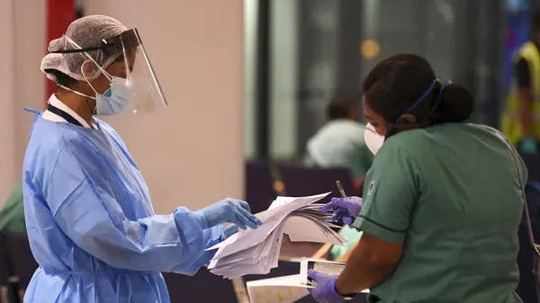 A member of a medical team registers upon her arrival at Dubai International Airport. (File photo: AFP)