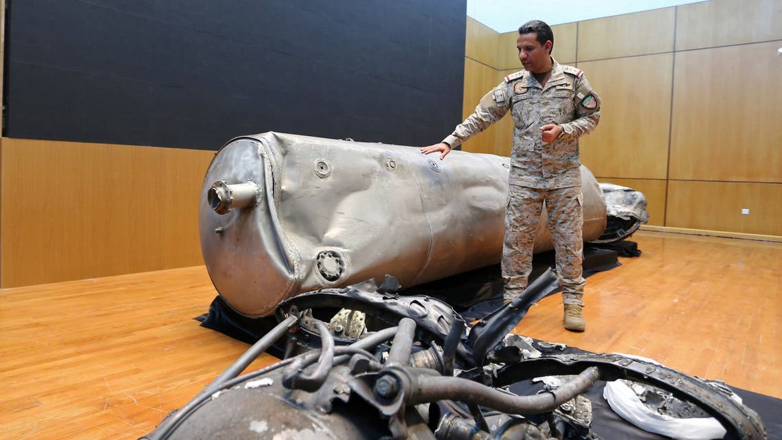 Arab Coalition spokesman Colonel Turki al-Malki displays the debris of a ballistic missile which he says was launched by Yemen's Houthi group towards the capital Riyadh, during a news conference in Riyadh, Saudi Arabia on March 29, 2020. (Reuters)
