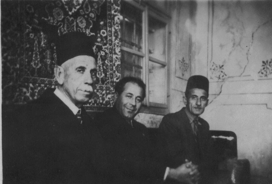 A historical photograph of Antoun Saadeh (center), the head of the SSNP, with two of Makhlouf's descendants. (Twitter, @MichaelARPage)