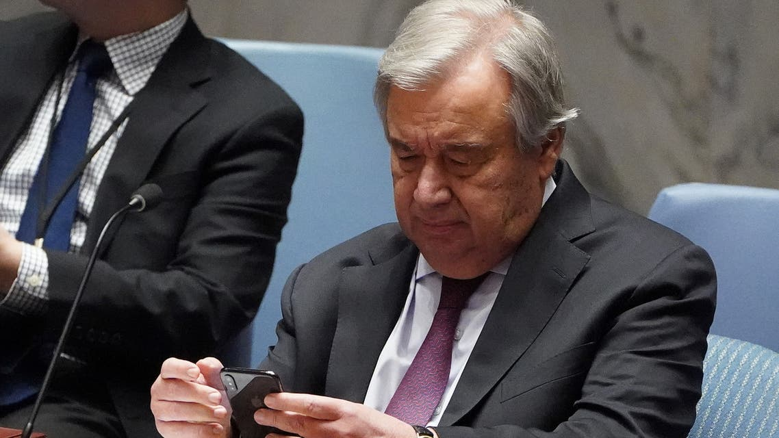 Secretary General of the United Nations Antonio Guterres looks at his phone before a Security Council meeting about the situation in Syria at United Nations Headquarters in the Manhattan borough of New York City, New York, U.S., February 28, 2020. REUTERS/Carlo Allegri