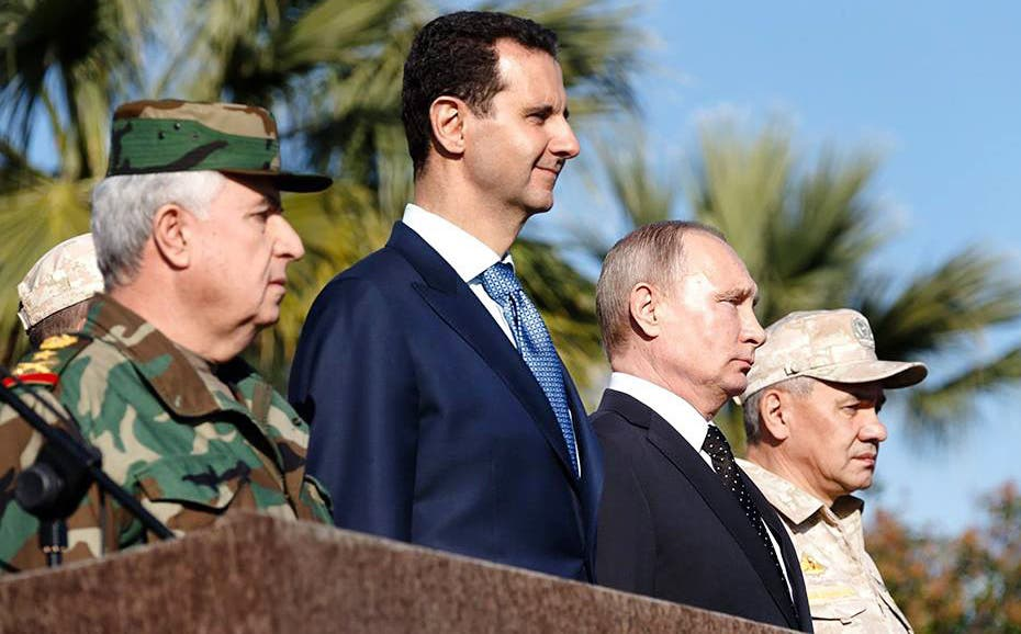 Assad with Putin during a recent visit.