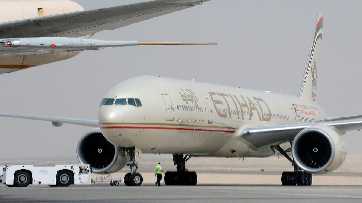 An engineer walks near an Etihad Airways aircraft at Abu Dhabi International Airport. (Reuters)