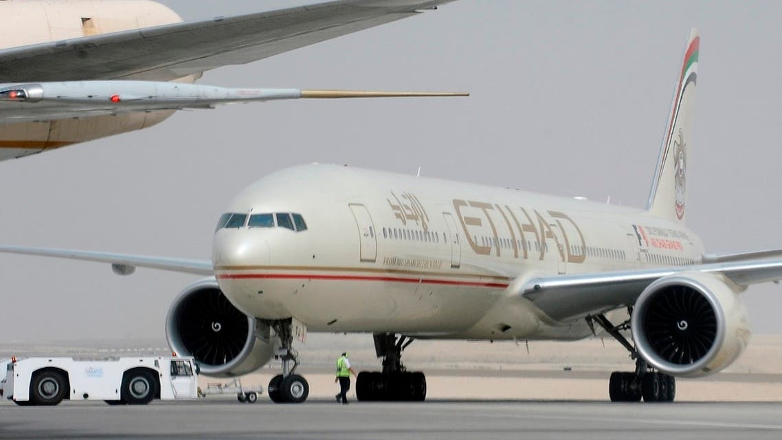 An engineer walks near an Etihad Airways aircraft at Abu Dhabi International Airport. (Reuters)