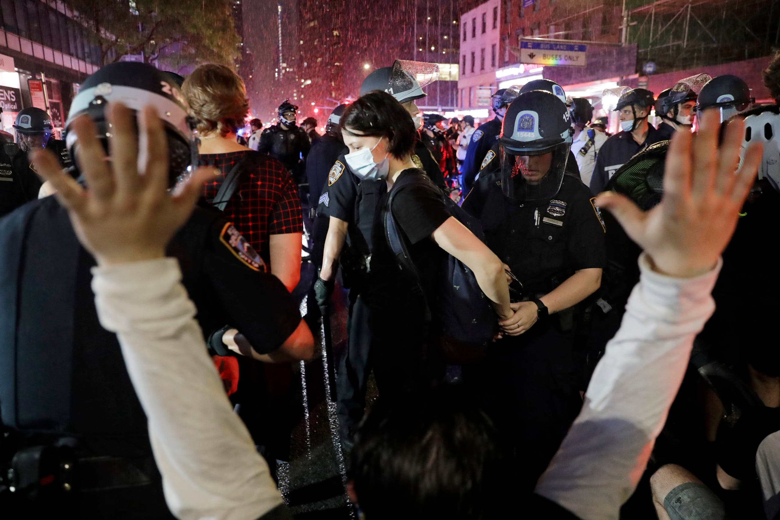 Police arrest protesters as they march through the streets of Manhattan, New York, on June 3, 2020. (AP)
