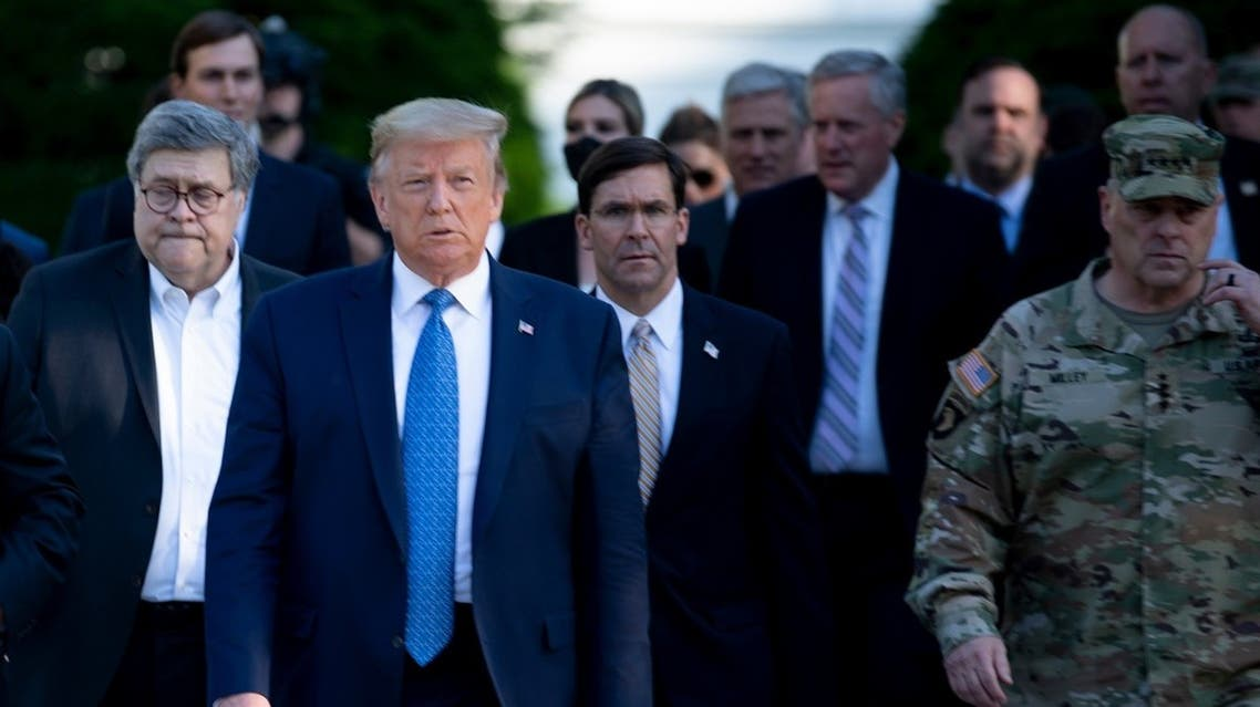 US President Trump and Secretary of Defense Mark Esper (C) walk to visit St. John's Church, June 1, 2020. (AFP)