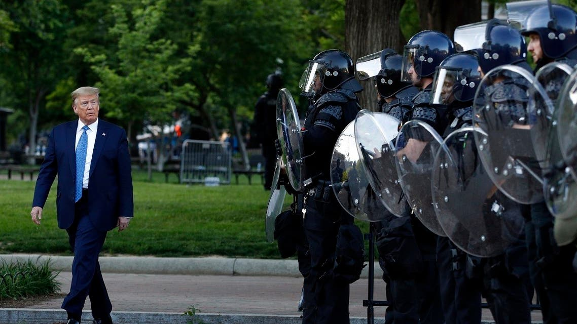 Trump walks past police in Lafayette Park after he visited outside St. John's Church across from the White House Monday, June 1, 2020, in Washington. (AP)