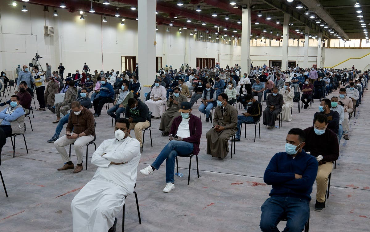 Expatriates wait for mandatory coronavirus testing in a makeshift testing centre in Mishref, Kuwait March 14, 2020.(Reuters)