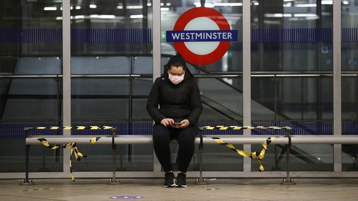 A woman wearing a protective face mask is seen at Westminster tube station. (Reuters)