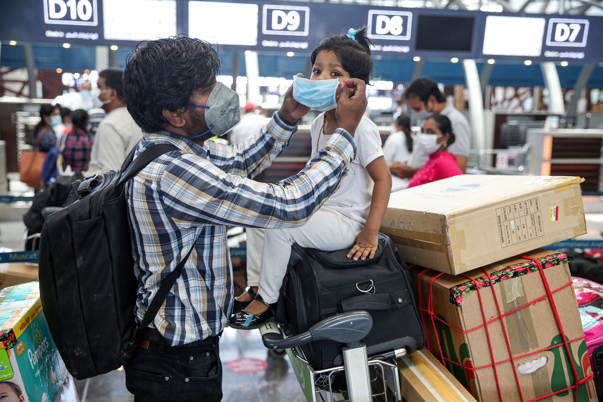 Members of an Indian family check in at the Muscat International Airport.(File photo)