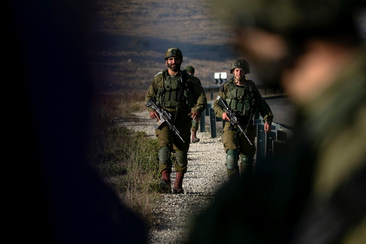 Israeli soldiers stand guard near the scene of a reported car-ramming attack north of the city of Ramallah in the Israeli-occupied West Bank, on May 29, 2020. (File photo: AFP)