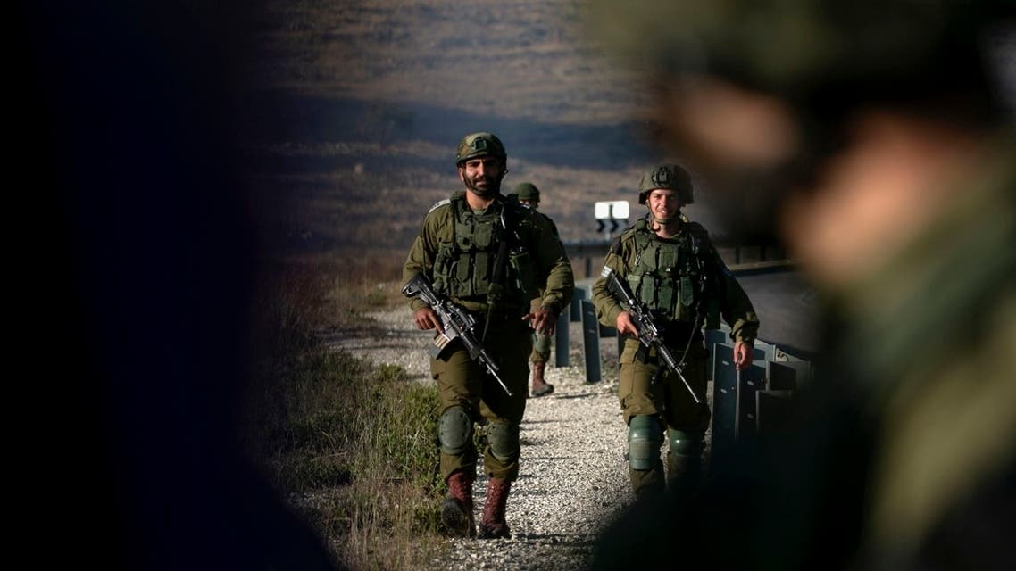 Israeli soldiers stand guard near the scene of a reported car-ramming attack north of the city of Ramallah in the Israeli-occupied West Bank, on May 29, 2020. (AFP)