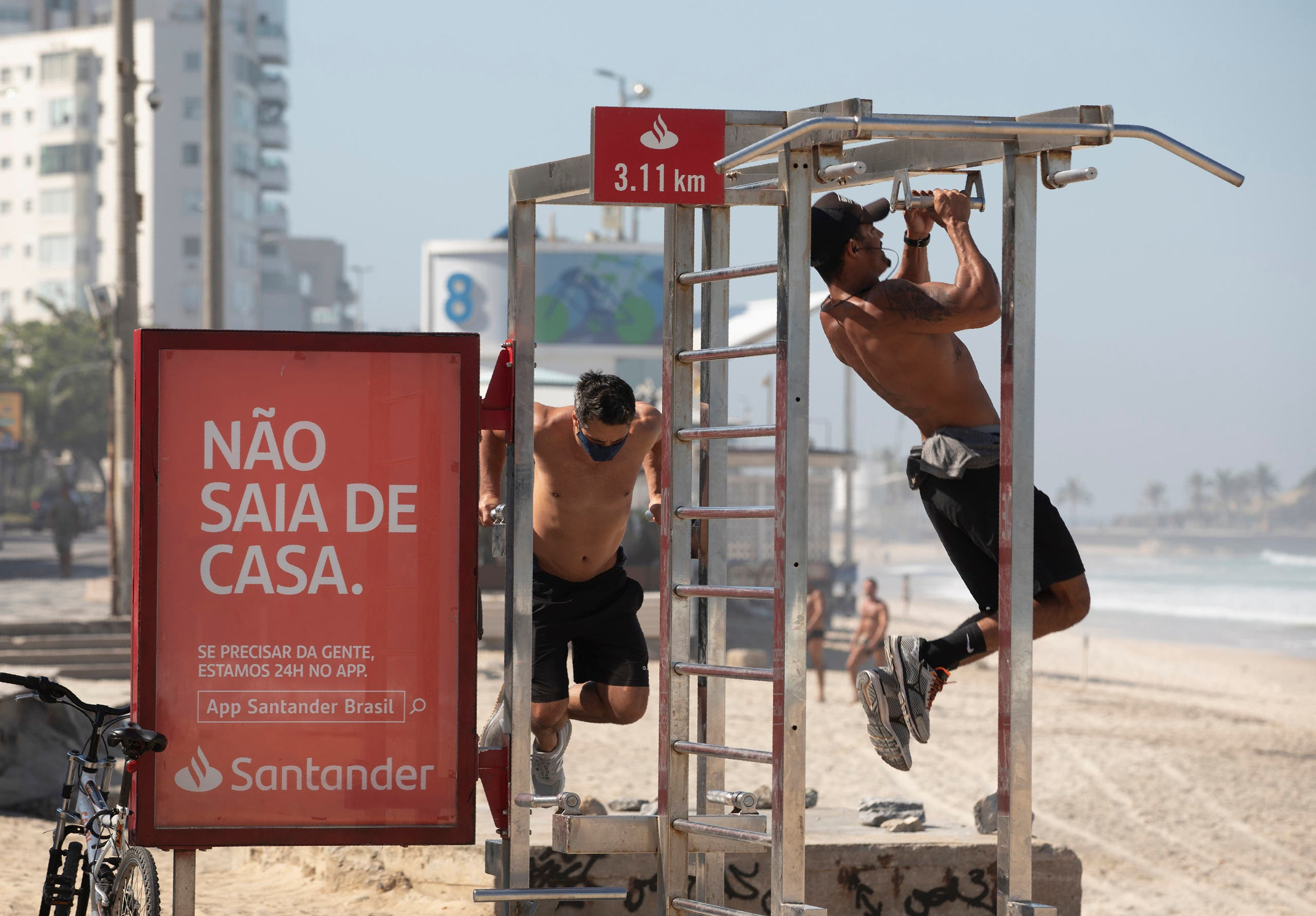 Men exercise on gym equipment on the sidewalk of Ipanema beach in Rio de Janeiro, Brazil on June 2, 2020. (AP)