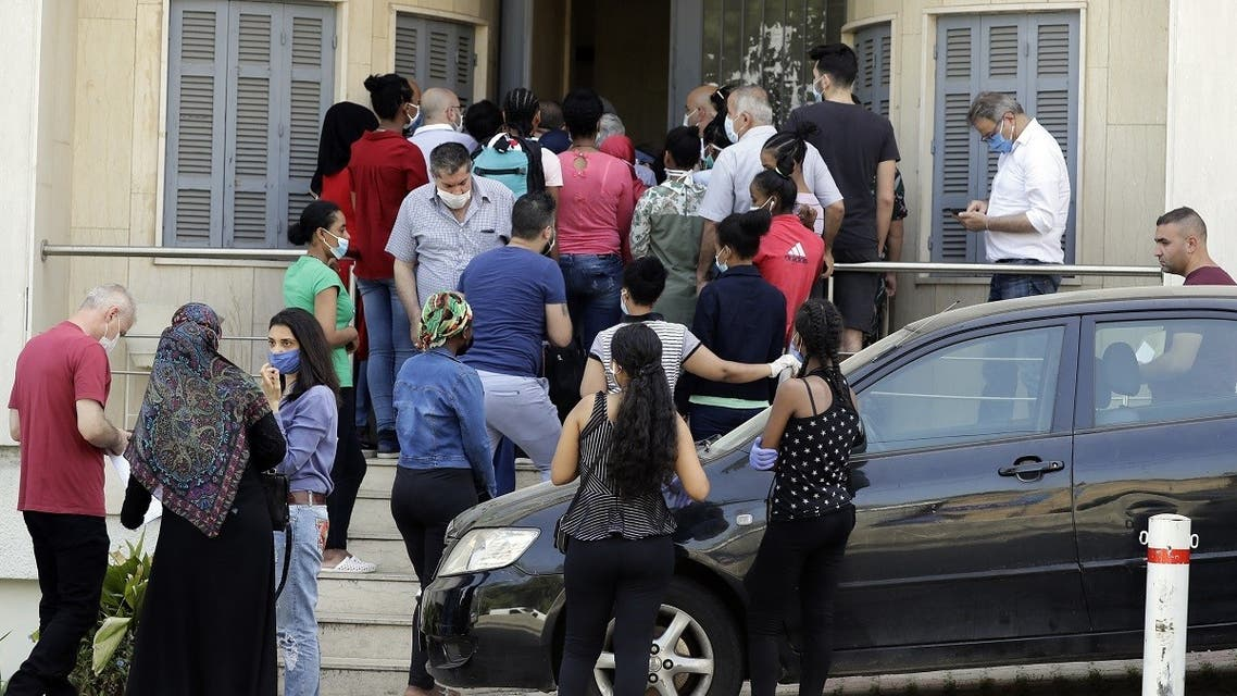Ethiopian domestic workers wait outside their country's consulate to register for repatriation, in Hazmieh suburb of the Lebanese capital Beirut on May 18, 2020. (AFP)