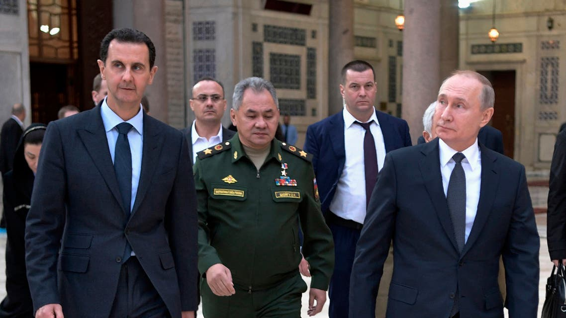 Russian President Vladimir Putin, right, Syrian President Bashar Assad, left, and Russian Defense Minister Sergei Shoigu, center, visit the Umayyad Mosque in Damascus, Syria, Tuesday, January 7, 2020. (File photo: AP)