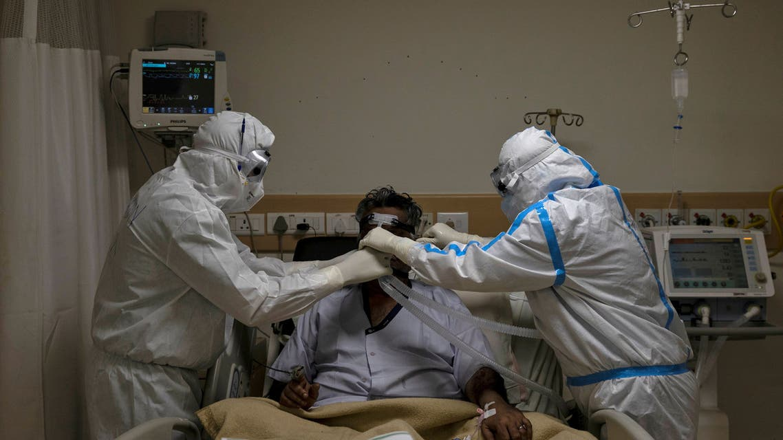 FILE PHOTO: Medical workers wearing personal protective equipment (PPE) take care of a patient suffering from the coronavirus disease (COVID-19), at the Intensive Care Unit (ICU) of the Max Smart Super Speciality Hospital in New Delhi, India, May 28, 2020. REUTERS/Danish Siddiqui/File Photo