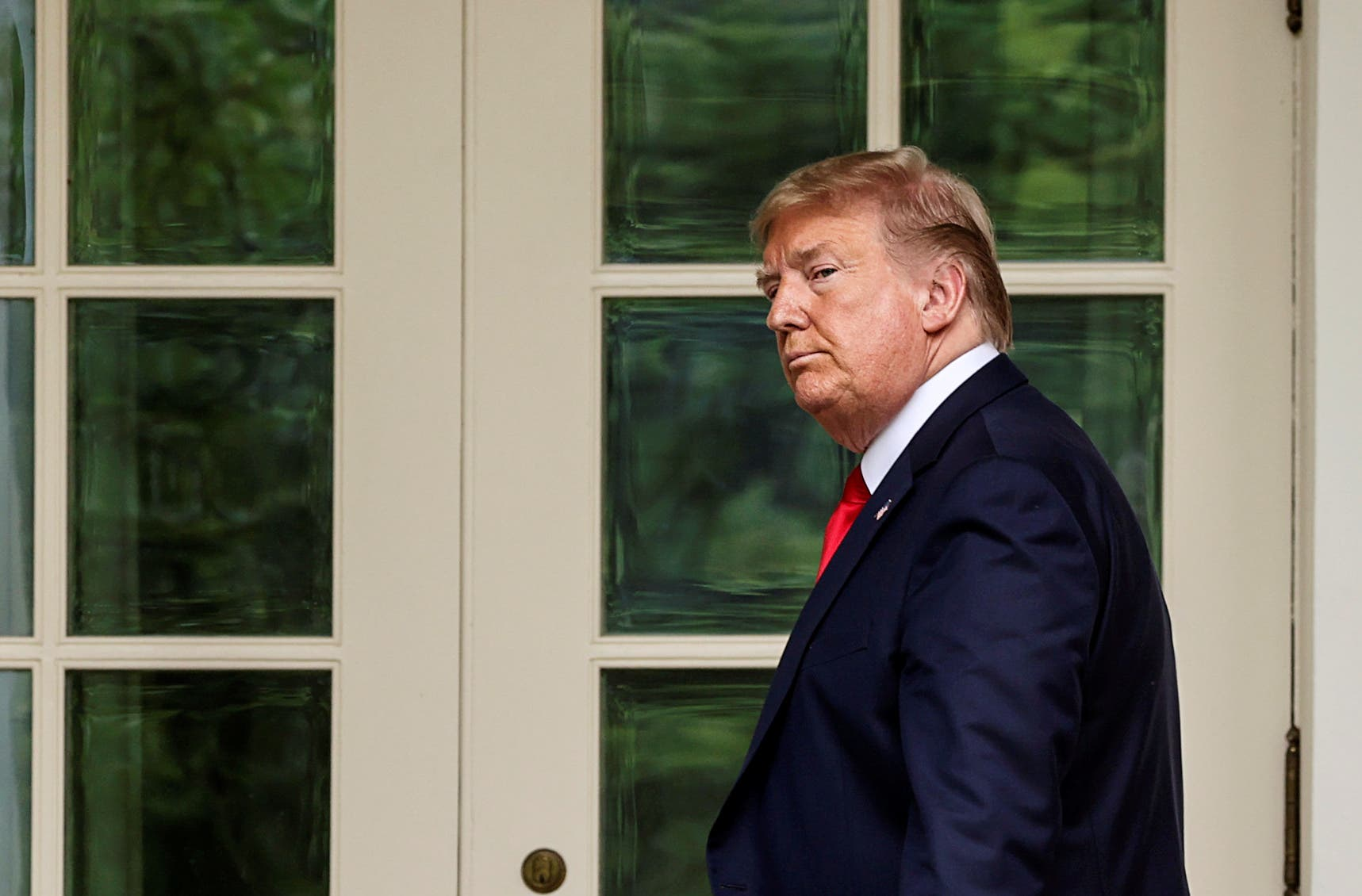 US President Donald Trump departs amid reporters asking questions after the president made an announcement about US trade relations with China, May 29, 2020. (Reuters)