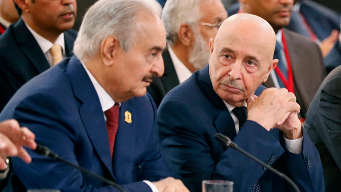 Libyan National Army's Field Marshal Khalifa Haftar (L) speaks with Libya's parliament speaker based in the eastern town of Tobruk Aguila Saleh Issa (C), during an International Congress on Libya at the Elysee Palace in Paris, on May 29, 2018. Rival Libyan leaders vying for influence in the fractured and war-scarred country meet in Paris for a major peace conference seen as a risky French-backed push for a political settlement in the country.
