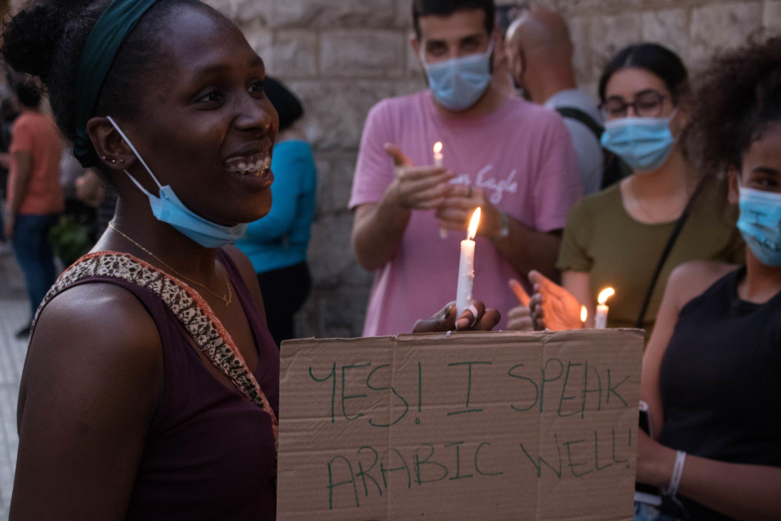 A black Lebanese woman attends a vigil for George Floyd in Beirut, Lebanon. (Nicholas Frakes)