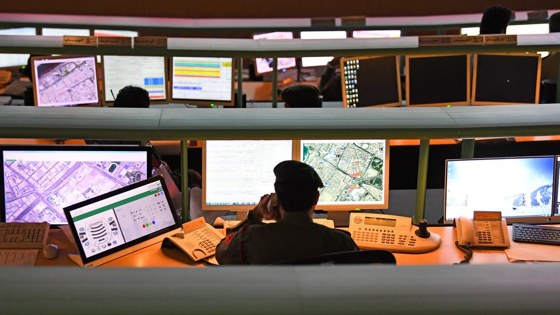 Police officers monitor the streets and receive calls from citizens at the Command and Control Center of Dubai Police in the Gulf emirate. (AFP)