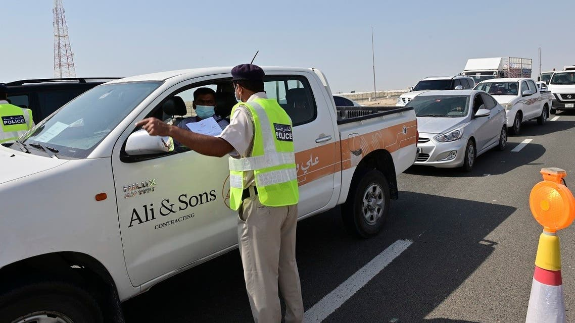 Emirati security forces man a checkpoint at the entrance of Abu Dhabi, on the highway linking Dubai to the capital, on June 2, 2020, after authorities cordoned off the city for a week to rein in the novel coronavirus. (AFP)