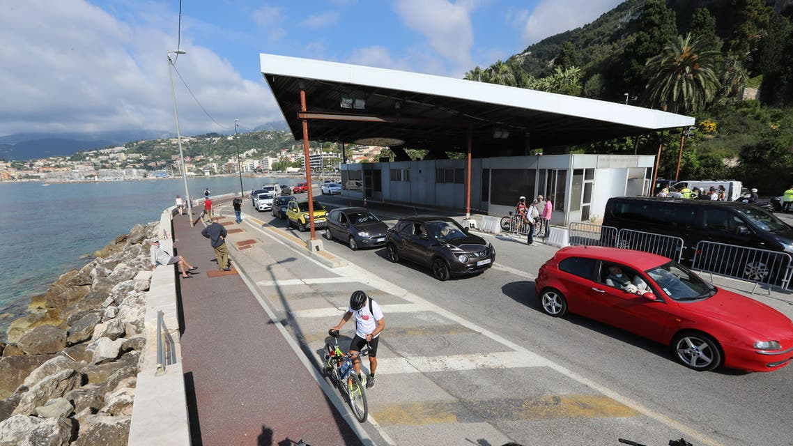 Vehicles queue to cross the French-Italian border near Menton on June 3, 2020 as Italy reopened its frontiers with Europe, three months after the country went into coronavirus (COVID-19) lockdown.