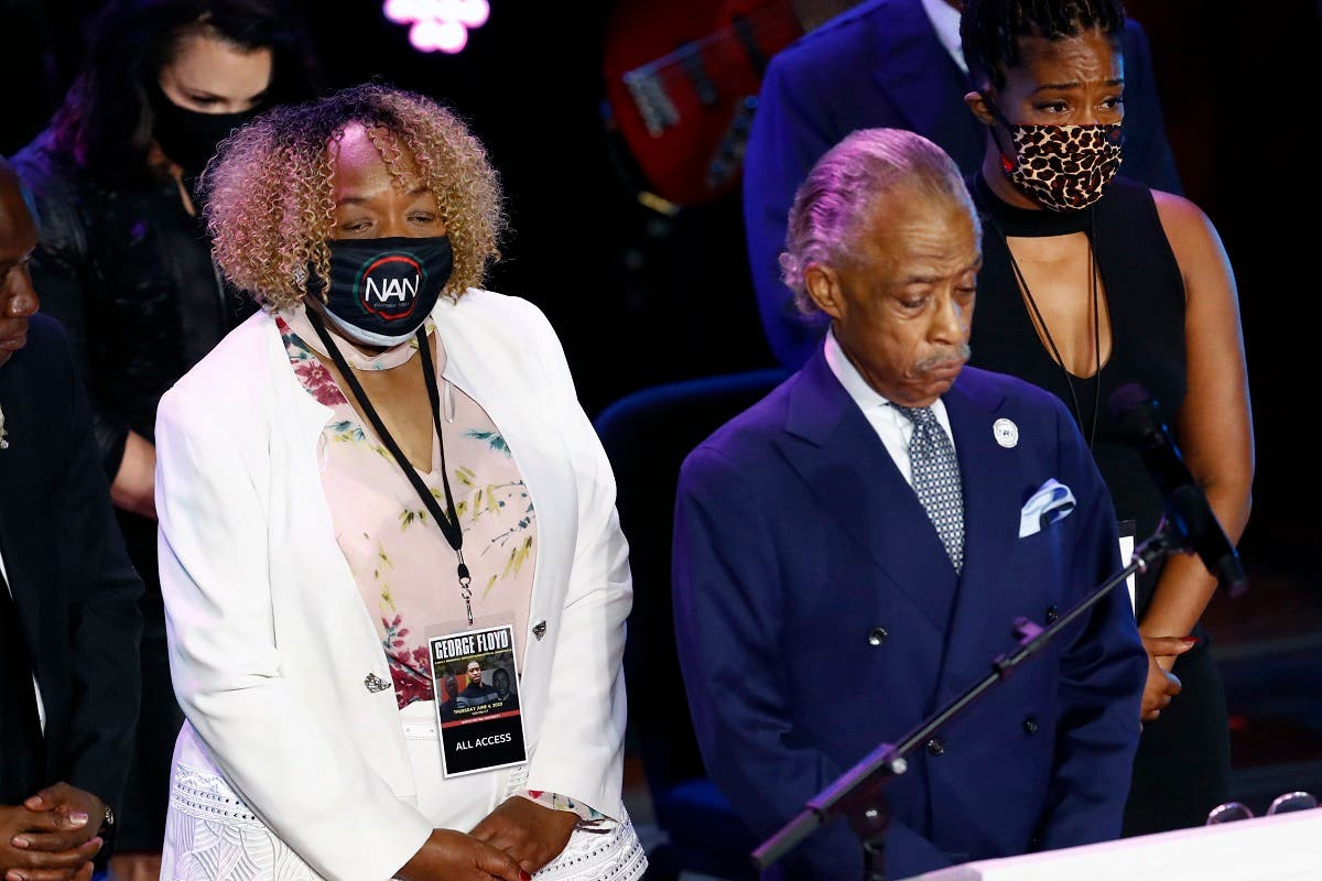 Eric Garner's mother, Gwen Carr left, joins the Rev. Al Sharpton, center and entertainer Tiffany Haddish left on stage for 8 minutes, 46 seconds of silence during a memorial service for George Floyd at North Central University Thursday, June 4, 2020, in Minneapolis. (AP)