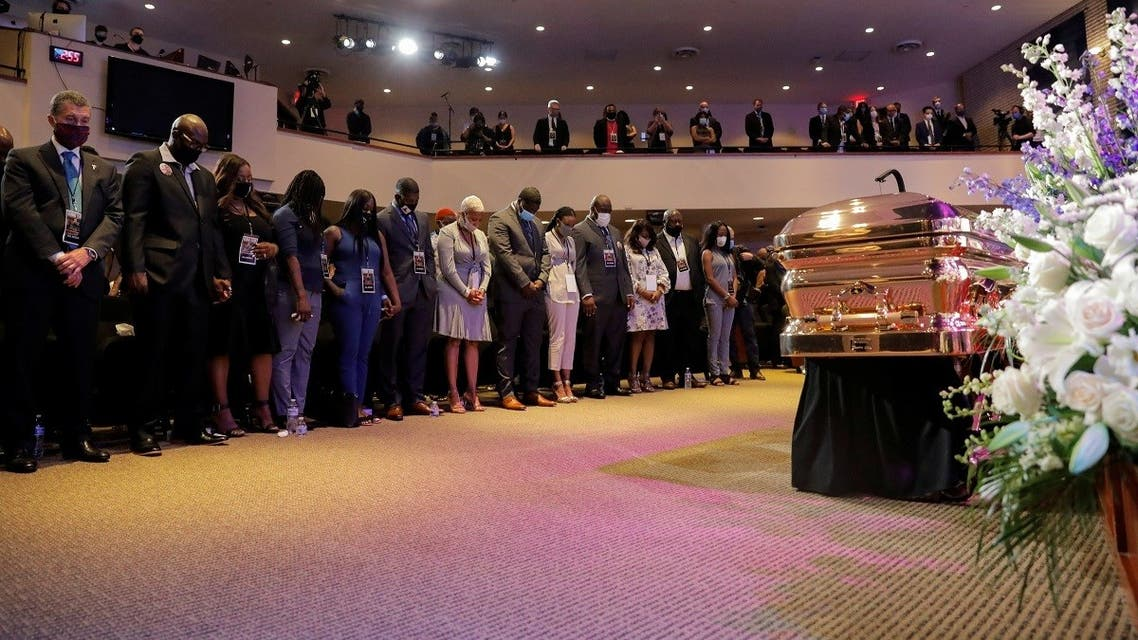 People attending a memorial service for George Floyd stand in respect, Minneapolis, Minnesota, US, June 4, 2020. (Reuters)