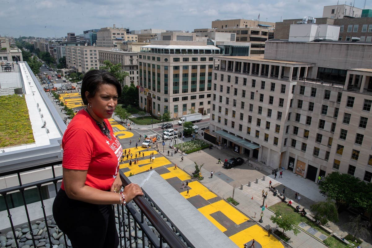 Mayor Muriel Bowser looks out over a Black Lives Matter sign that was painted on a street, during nationwide protests against the death in Minneapolis police custody of George Floyd, in Washington, DC. (Reuters)