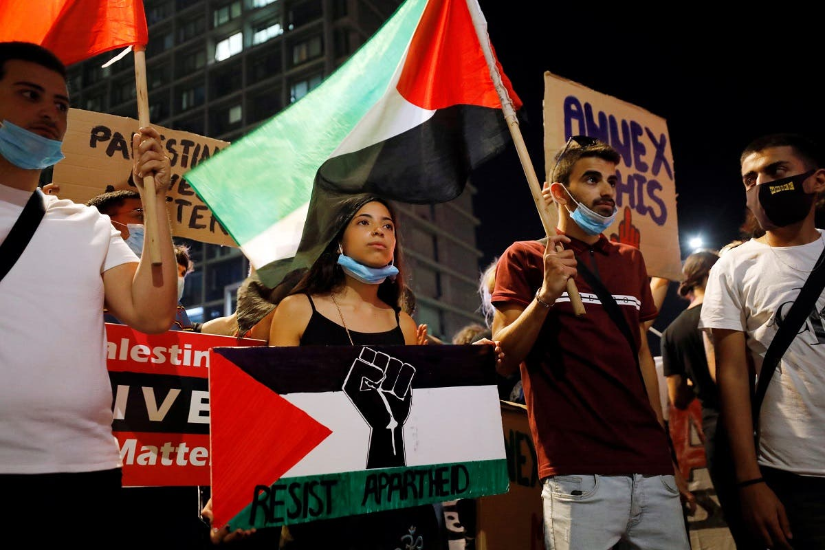 Demonstrators protest under coronavirus restrictions against Israeli Prime Minister Benjamin Netanyahu's plan to annex parts of the Israeli-occupied West Bank, in Tel Aviv, Israel. (Reuters)