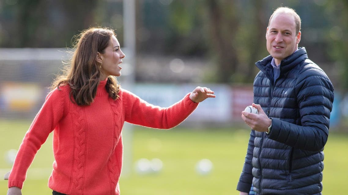 Britain's Prince William, Duke of Cambridge (R) and Britain's Catherine, Duchess of Cambridge attempt to play hurling during a visit to Salthill Gaelic Athletic Association (GAA) club in Galway, western Ireland, on March 5, 2020 on the final day of their three day visit.