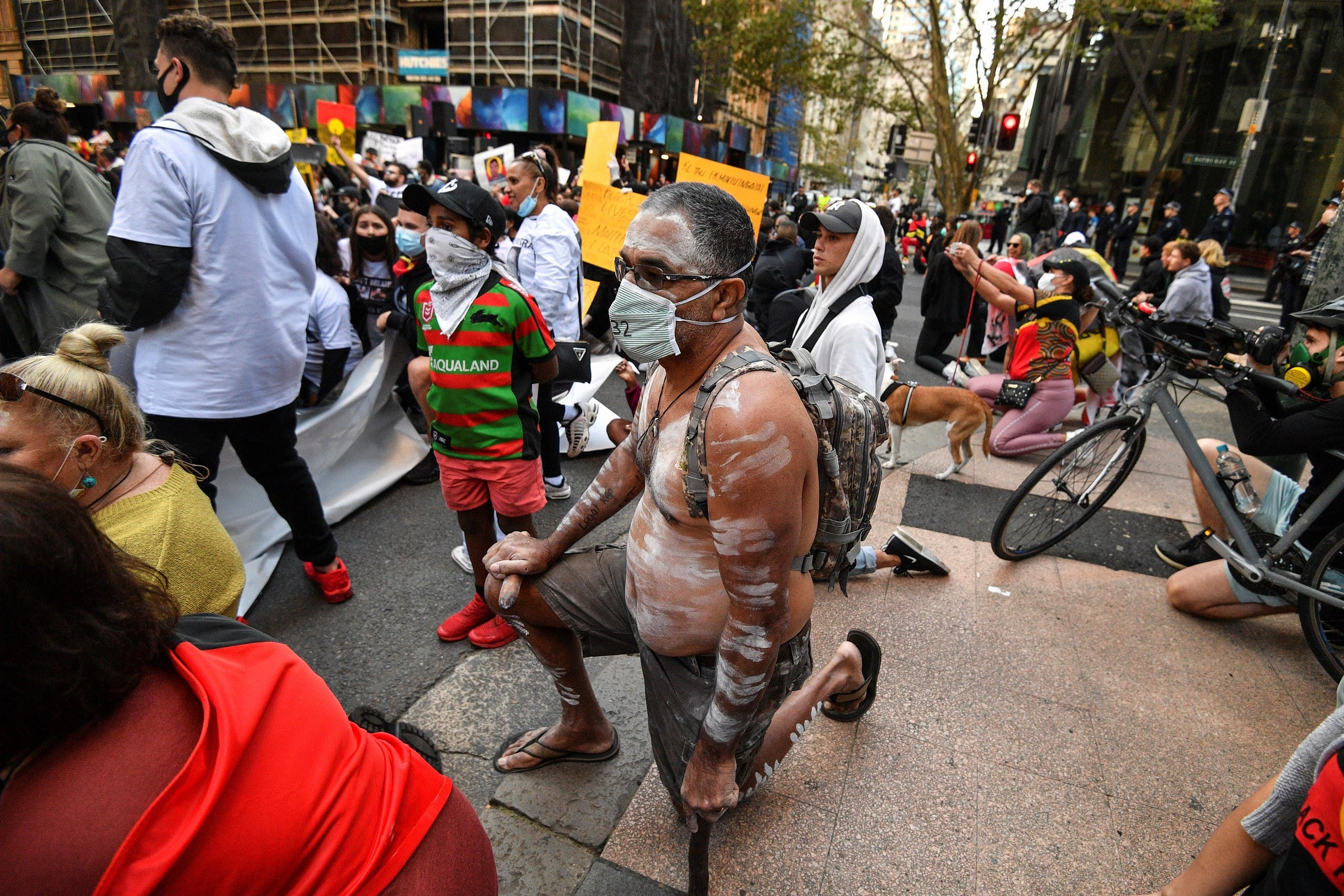 A man in aboriginal dress takes the knee in solidarity with Black Lives Matter protests, Sydney, Australia, June 6, 2020. (AFP)