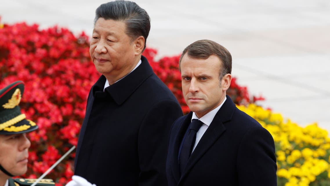 French President Emmanuel Macron attends a welcome ceremony with Chinese President Xi Jinping outside the Great Hall of the People in Beijing